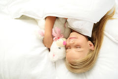 Girl lying on the bed stock photos