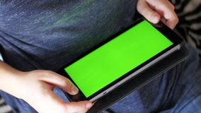 Girl lying on bed and using tablet with green screen at home. Girl Lying on Bed and using Tablet with Pre-Keyed Green Screen at Home. Woman hands using digital stock footage