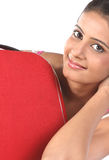 Girl lying behind the red suitcase Stock Images