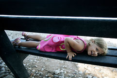 Girl lying on bench Stock Image