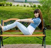 Girl lying on bench Royalty Free Stock Photo