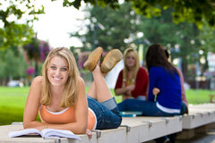 Girl Lying on a Bench Stock Photo