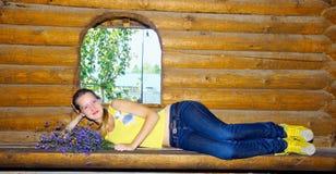 Girl lying on bench of bathhouse Stock Photography