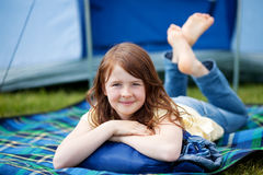 Girl Lying On Blanket With Tent In Background Stock Photos