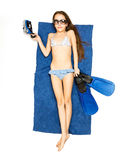 Girl lying on blue towel with flippers and snorkeling mask Royalty Free Stock Photos