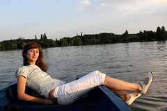 Girl lying on a boat Stock Photo