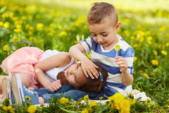 Girl lying with the boy Royalty Free Stock Photography