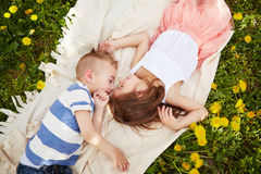 Girl lying with the boy Royalty Free Stock Image