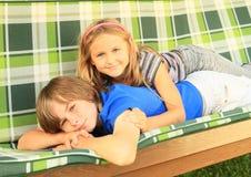 Girl lying on boy Royalty Free Stock Image