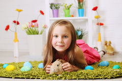 Girl lying on the carpet. With a rabbit Royalty Free Stock Photo