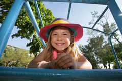 Girl lying on a climbing frame Stock Images