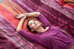Girl lying on colorful sheets. Attractive Girl lying on colorful sheets Royalty Free Stock Photo