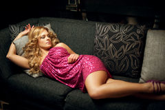 Girl lying on a couch Stock Photography