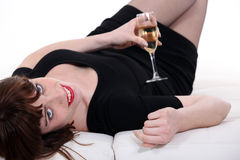 Girl lying on a couch Royalty Free Stock Image
