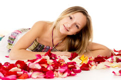 Girl lying in covered by flower petals Stock Images