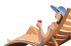 Girl lying in a deck chair and drinking wine Royalty Free Stock Images