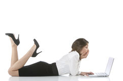 Girl lying on the desk Stock Photos