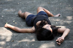 Girl lying down bare feet Stock Photo