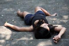 Girl lying down bare feet