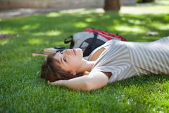 Girl lying down at college campus Stock Photo