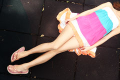 Girl lying down in a colorful dress Royalty Free Stock Images