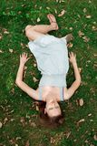 Girl lying down of grass Royalty Free Stock Image