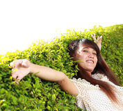 Girl lying down of grass Stock Images