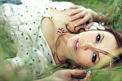 Girl lying down of grass Royalty Free Stock Photography