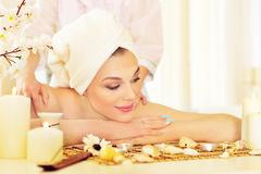 Girl lying down on a massage bed Royalty Free Stock Photography