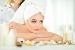 Girl lying down on a massage bed Royalty Free Stock Photos