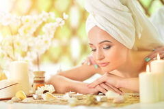 Girl lying down on a massage bed Royalty Free Stock Images