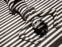 Free Girl Lying Down On A Floor With Shadows. Royalty Free Stock Image - 136043746
