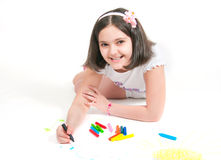 The girl lying draws white background Royalty Free Stock Photo