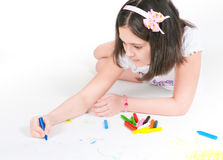 The girl lying draws white background Royalty Free Stock Photography