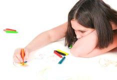 The girl lying draws white background Stock Photos