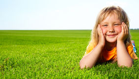 Girl lying in field Stock Photos