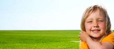 Girl lying in field Stock Image