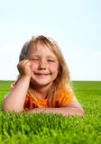 Girl lying in field Stock Photography