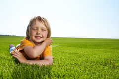 Girl lying in field Royalty Free Stock Photo