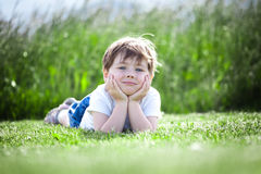 Girl lying in field Royalty Free Stock Photography