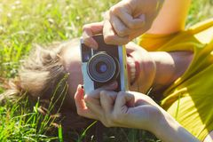 Girl lying with film camera Stock Image
