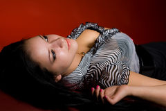 Girl lying on the floor Royalty Free Stock Images