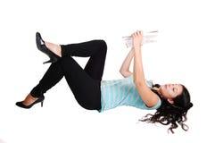 Girl lying on floor. Stock Image