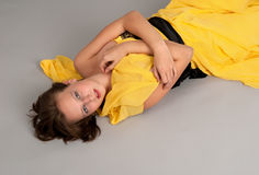 A girl lying on the floor Royalty Free Stock Photography