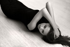 Girl lying on the floor. Attractive girl lying on the floor of the wood Royalty Free Stock Image