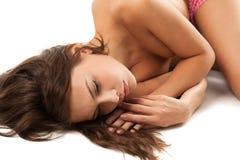 Girl lying on floor Royalty Free Stock Image