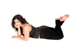 Girl lying on floor. Stock Photography