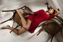 Girl lying on floor Stock Photos