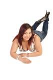 Girl lying on floor. Stock Images