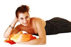 Girl lying on floor. Royalty Free Stock Photos